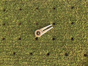 Greens are cored to 35mm depth with 10mm tine at 35mm spacing.